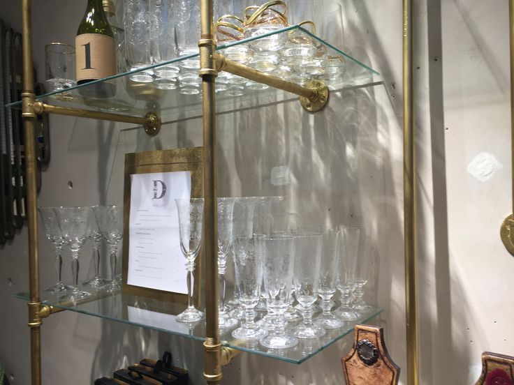 Gas Pipe Shelving Unit...paint gold and add glass shelves.