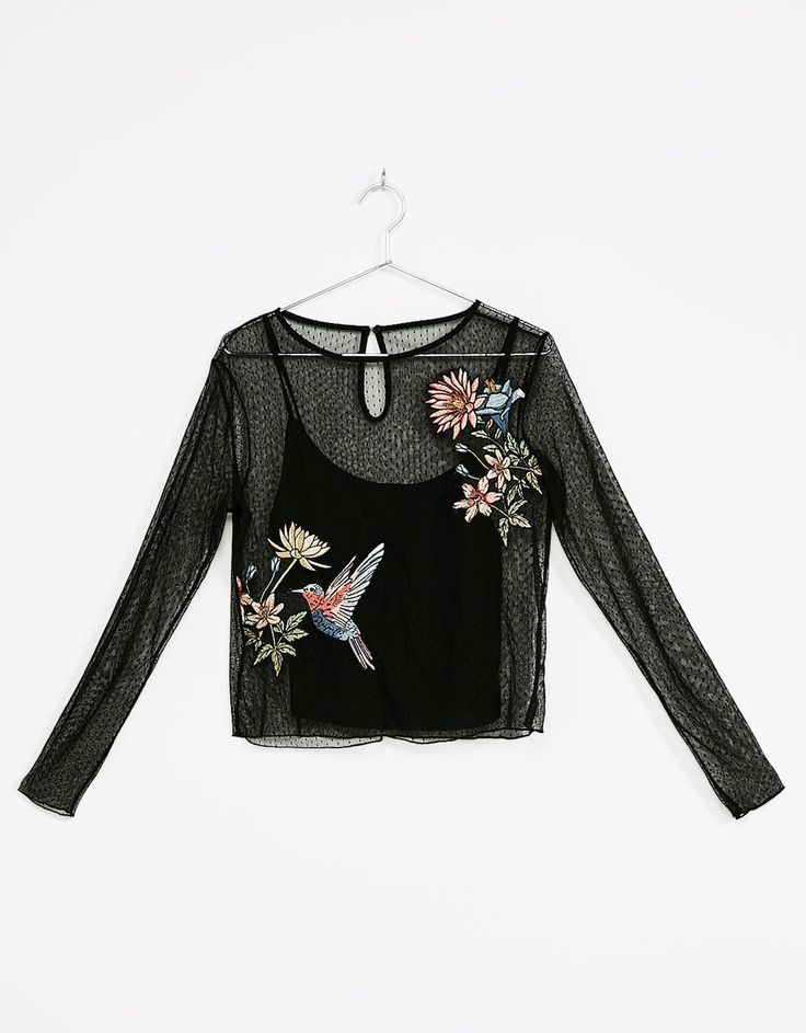 Plumetis top with floral patches. Discover this and many more items in Bershka with new products every week