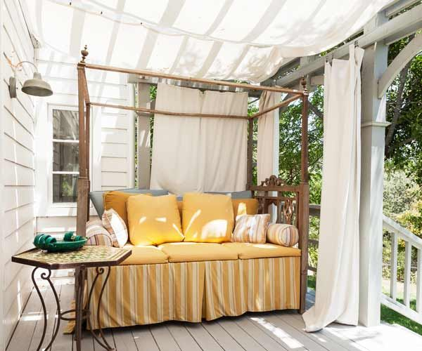 Cotton canvas treated to resist moisture can serve as a temporary awning when suspended from a pergola with ties or metal clips. |Photo: Mark Lohman | thisoldhouse.com