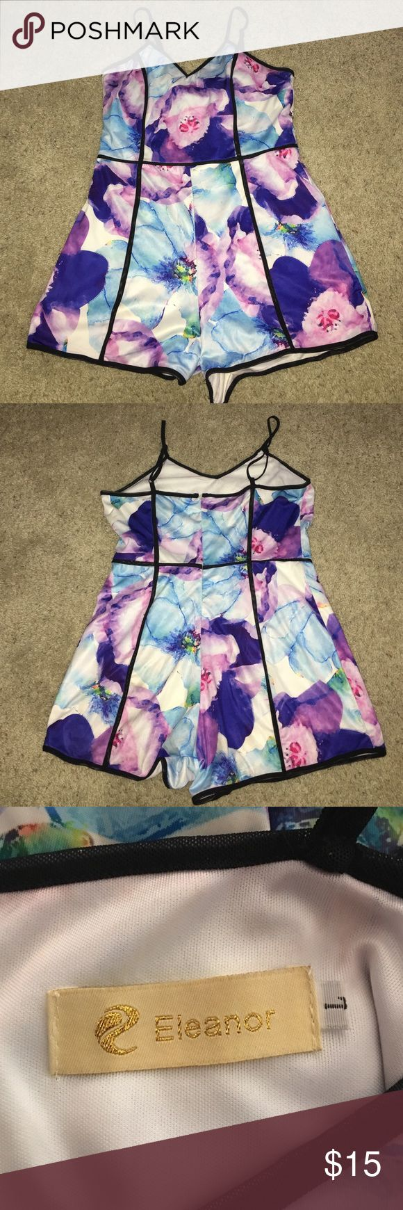 Women's Floral Romper Women's Floral Romper. Size L. Only been worn once. Zip up in the back with adjustable sleeves. Eleanor Pants Jumpsuits & Rompers