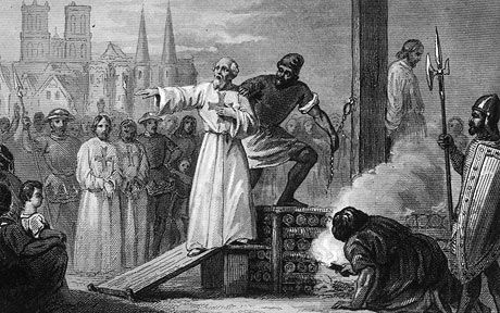 Jacques de Molay, the 23rd and Last Grand Master of the Knights Templar, is lead to the stake to burn for heresy.