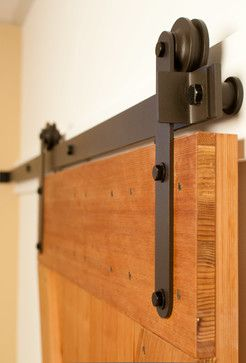 Interior Sliding Barn Door Hardware Is Rustic And Exposed. The Rollers  Create Smooth Operation.