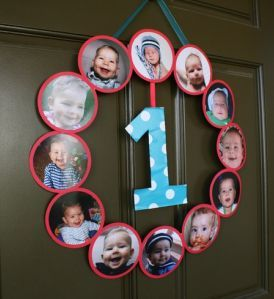 This 1st birthday wreath greets guests with a year full of pictures.  See more first boy birthday and party ideas at one-stop-party-ideas.com