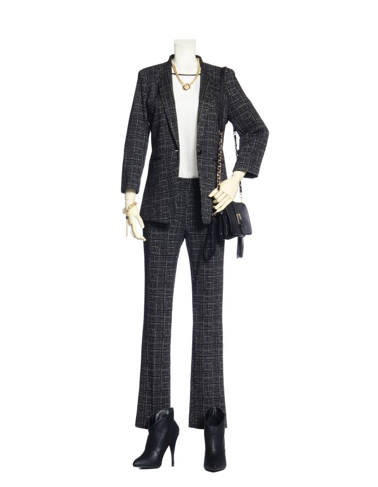 The new power look for fall goes back to the tailored suit but the look is now narrow and neat. Softer feminine shoulders and fitted sleeves on the jacket flatter slim pants or skirts. Fabrics have pattern or texture which gives the suit a whole new twist. | @Le Chateau