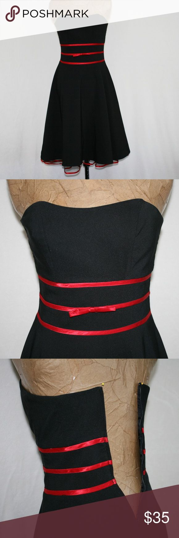 B. Smart Black and Red Prom Homecoming Dress Cute black dress with a hint of netting at the bottom with red satin ribbon edge.  Great for prom, homecoming or any other fancy occasion.  Bust is 30 inches, waist is 27, back length from center back down is 32 inches.  58% rayon, 39% polyester, 3% spandex.  (1210) B. Smart Dresses Prom