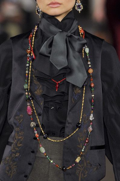 more of a bow that seems to come from a tie, but a small scarf can achieve the same classy effect!     Ralph Lauren Fall 2013