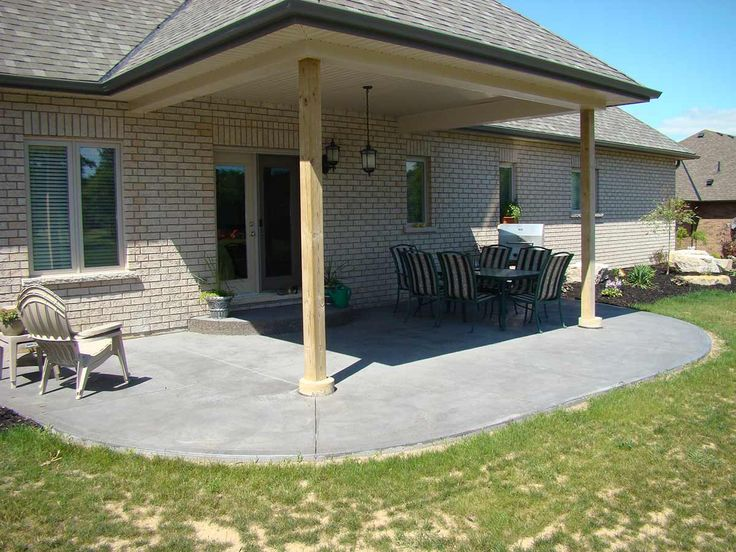 Coloured, textured grey concrete patio, great for entertaining in your backyard.