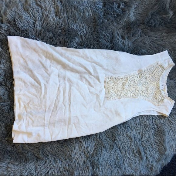 Free People White Dress This dress is in good condition, has a cute lace cut out in the front and has buttons going up the back Free People Dresses