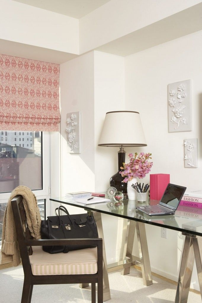 Glass desk visually takes up less space in small rooms - white room with pink pop - chic & stylish - very inviting home office