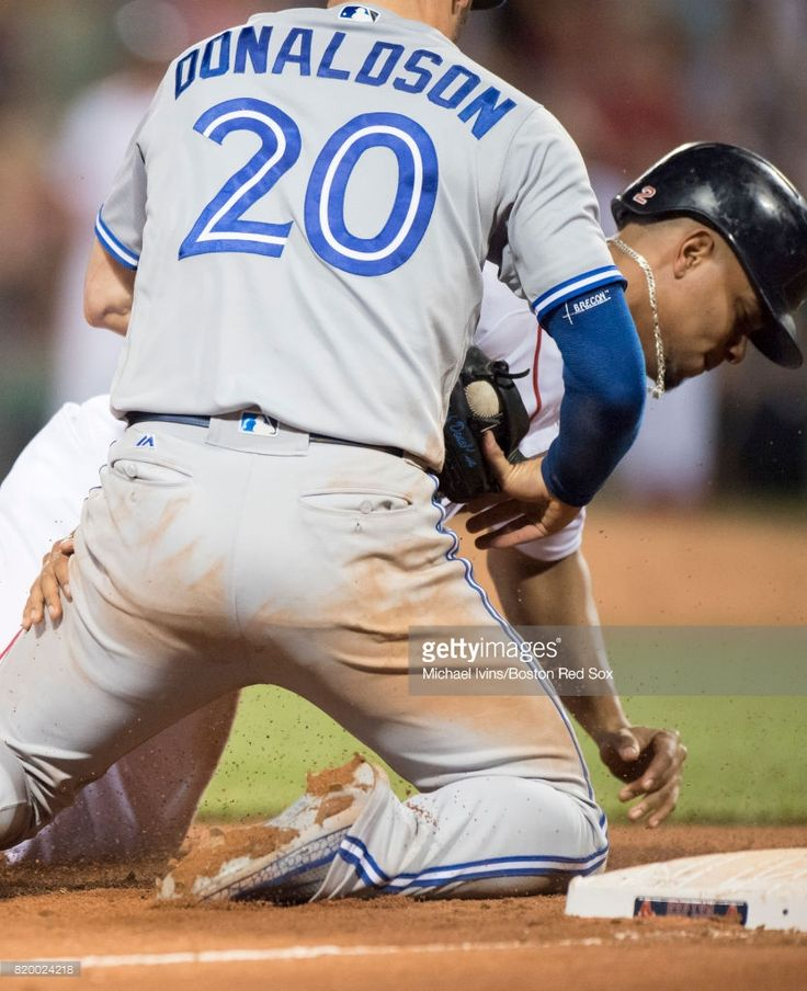 Josh Donaldson #20 of the Toronto Blue Jays appears to bend his thumb backwards while tagging out Xander Bogaerts #2 of the Boston Red Sox in the eleventh inning at Fenway Park on July 18, 2017 in Boston, Massachusetts. (Photo by Michael Ivins/Boston Red Sox/Getty Images) Josh Donaldson;Xander Bogaerts