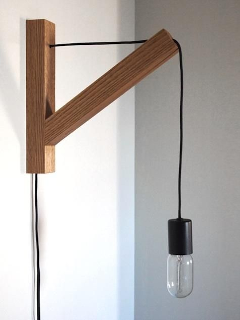 Two approaches to the simple bracket sconce; the first (more refined) option features a solid oak bracket and is designed by NY-based Dino Sanchez; the second features a low-cost bracket from Ikea and a cloth cord pendant from Nud in Sweden.