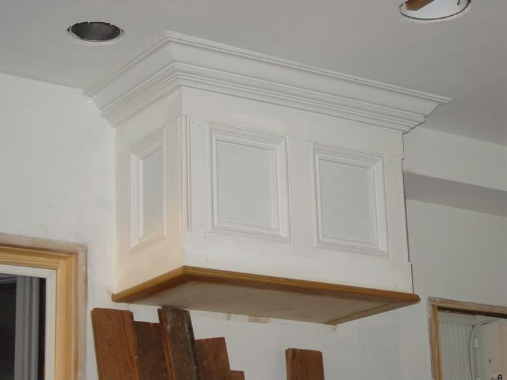 when removing the soffit is not feasible, one could try to trim it out to look like a cabinet?