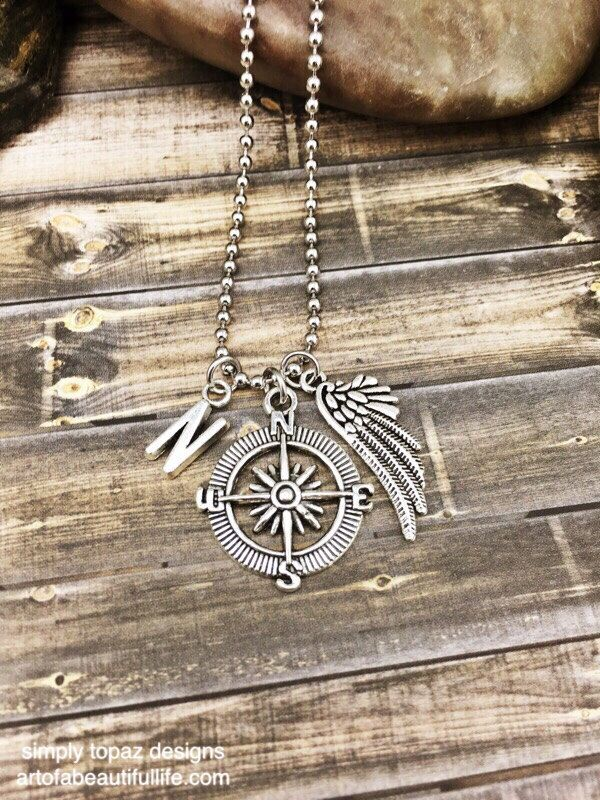 Wanderlust - Compass Necklace with Personalized Initial Charm and Wing - The perfect necklace for the gypsy soul that loves to travel ...by simply topaz   https://www.etsy.com/listing/254138459/compass-necklace-letter-charm-initial