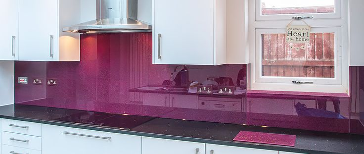 Purple coloured glass kitchen splashback by CreoGlass Design (London,UK). CreoGlass™ Splashbacks are toughened and impact resistant. Glass can with stand temperatures up to 400℃. #kitchen