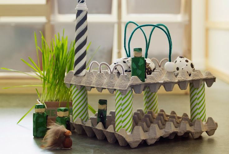 Close-up of a building made from egg boxes and cardboard, decorated with IKEA wrapping paper.