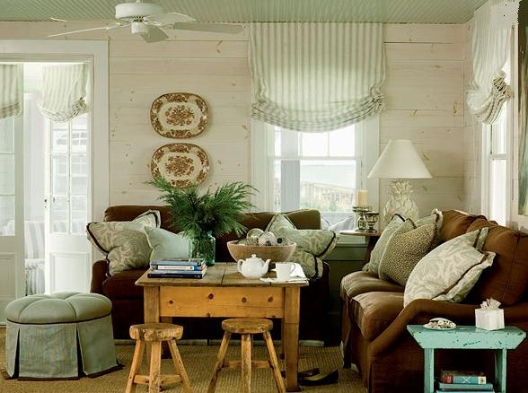 Like Brown Platters Couch Beadboard Ceiling Painted Green Whitewashed Wood Walls Throw Pillows
