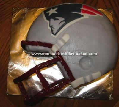 Crystal's Patriot Football  Cake: I made this Football cake for an '07 Superbowl party. My brother-in-law is a fan of the Patriots so I chose to use their helmet.   This is a three (9 in)