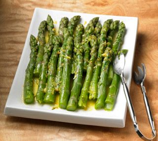 Steamed Asparagus with Citrus Butter: Vibrant-green asparagus tastily topped with citrusy butter.