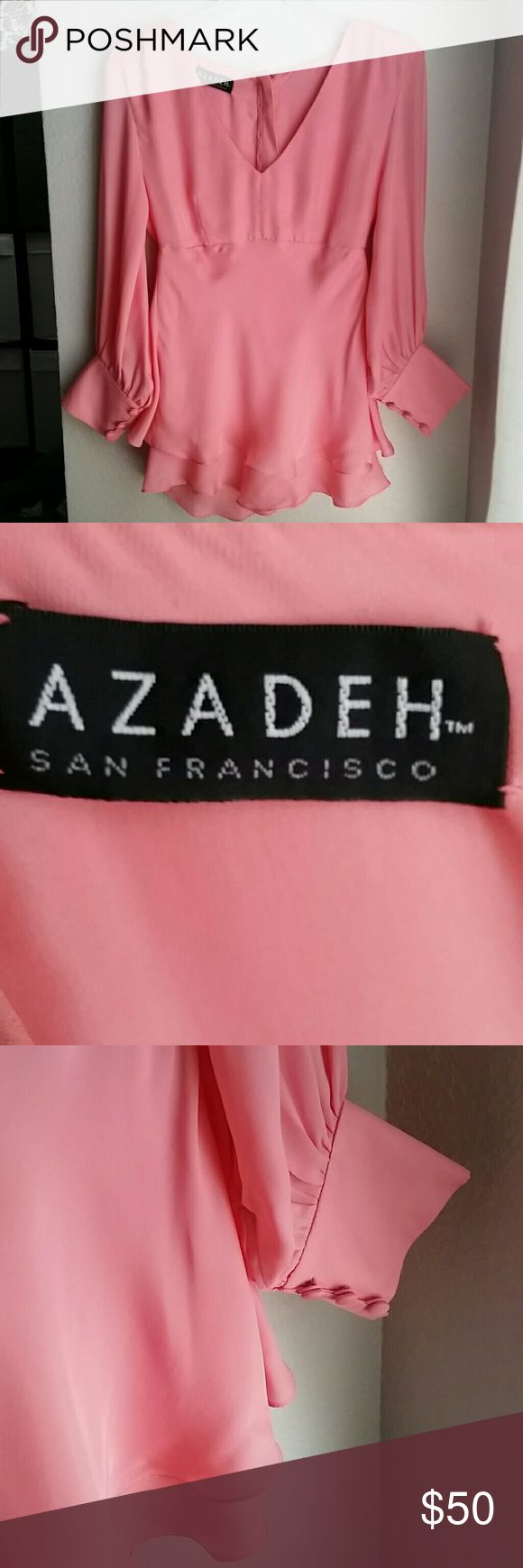 Azadeh Couture Coral Blouse - S/XS Excellent condition Azadeh of San Francisco coral blouse. I could not find any rips, holes,  or stains. There is no size tag or material tag, but I belive it is silk, as the material feels and behaves like silk (a few very minor pulls like silk tends to do). It measures approx. 27 inches from shoulder to bottom hem, 16 inches across the chest, and 14 inches at the waist. It's small, like a 2 or 4. Buttons up the back, no zippers. Please ask questions and…