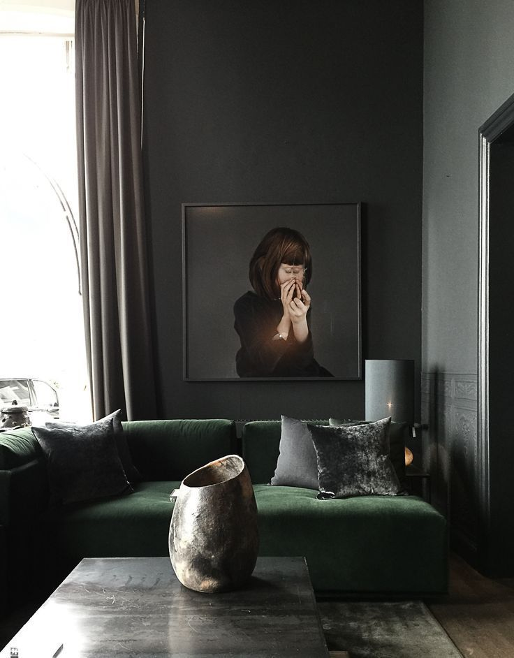 Dark And Modern Living Room Featuring A Green Velvet Couch Amazing Art And Floor To Ceiling Curtains In 2020 Dark Living Rooms Dark Interior Design Moody Living Room