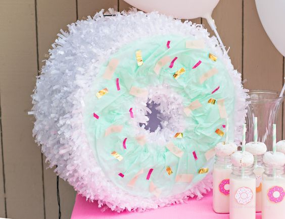 Donut Pinata Tutorial on shopfancythat.com!  Perfect for your donut themed birthday party!