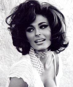 Big eyes, big brows, big hair, big style ...  man, the 60s was where it was at