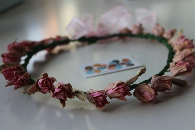Coronita de flores con lazo detras