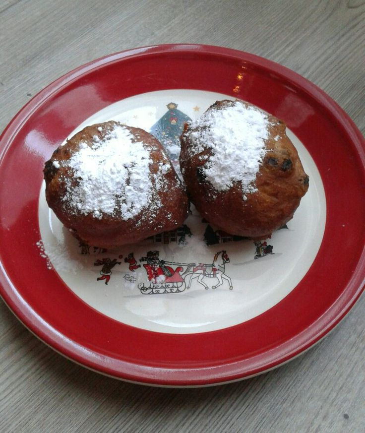Oliebollen. Dutch traditional food  on new years eve and new years day. Sort of doughnut dough with sultana's and raisens. Deep fried. Served with icing sugar.