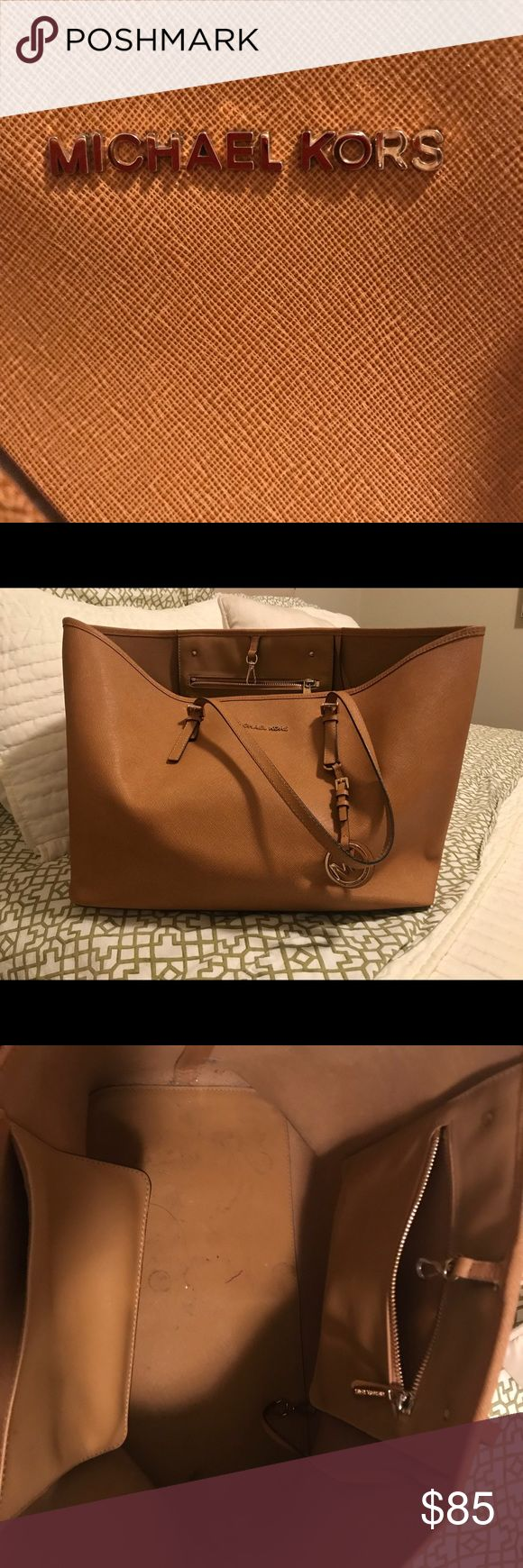 Michael Kors Purse Tan leather- no scratches or stains, just light ware and tear on the inside (photographed). Light ware and tear on shoulder straps (photographed). Other than that it is in supreme condition and stored in the dust bag when not in use! KORS Michael Kors Bags Shoulder Bags