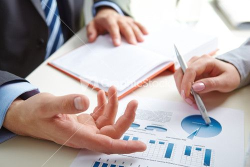 Male Hand Pointing At Paper Containing Data About Economic Situation