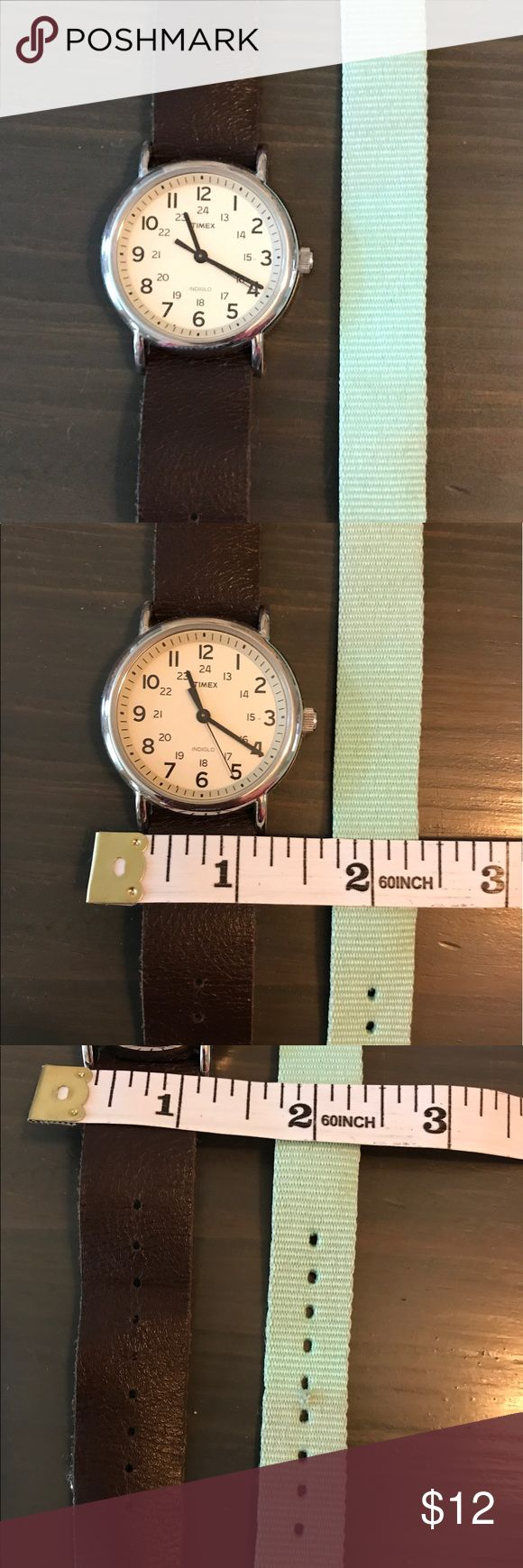 Authentic Timex Watch W/ Interchangeable Band Great soft leather band and cloth aqua band. Small wear on holes on cloth band, shown in pic. This watch is still ticking! Timex Accessories Watches
