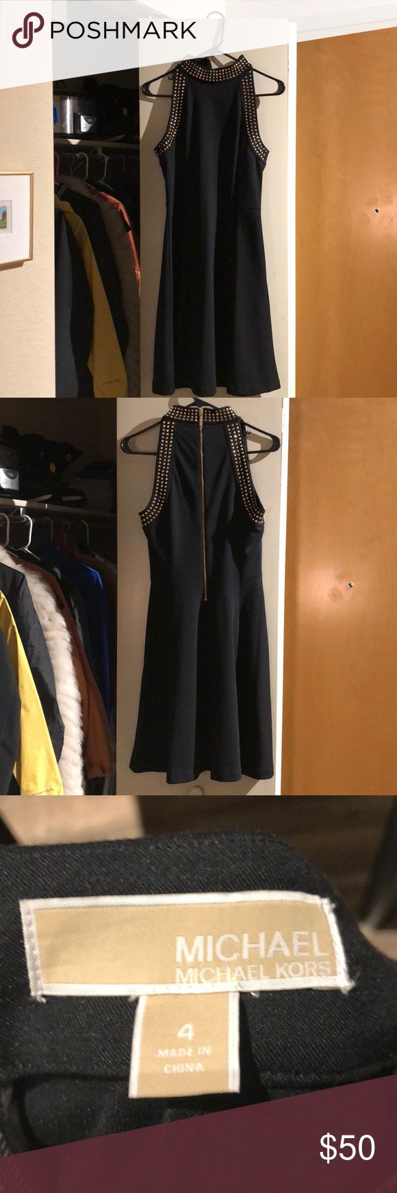 Women's Size 4 Michael Kors Dress Never worn! Gorgeous black and gold studded party dress. Knee length. Zip up back. MICHAEL Michael Kors Dresses Midi