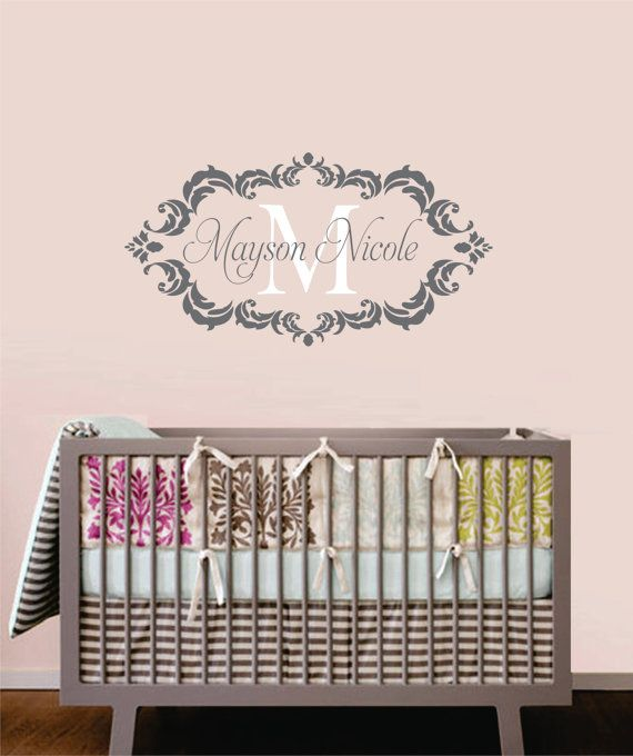 Name decal above the crib https://www.etsy.com/listing/121743469/childrens-decor-baby-nursery-wall-decal