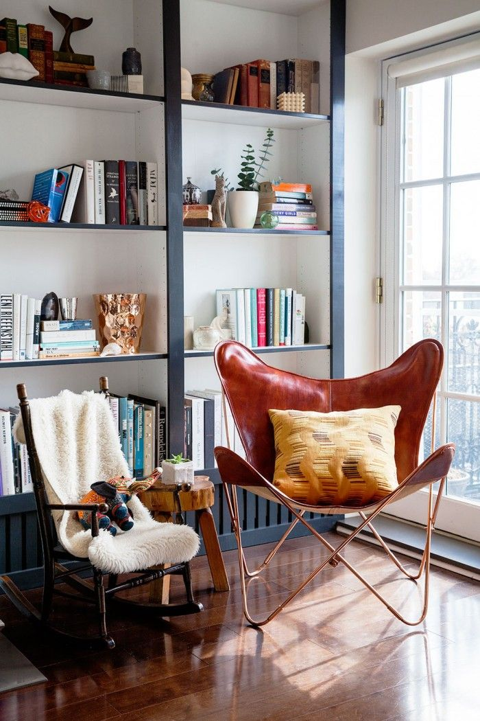 Irene Edwards had her BILLY bookcases framed with trim and the front pieces painted in a contrasting color—even accommodating baseboard heaters below!