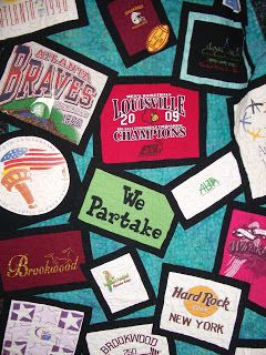 T-shirt quilt idea, love the common border around each shirt randomly placed on a common background.