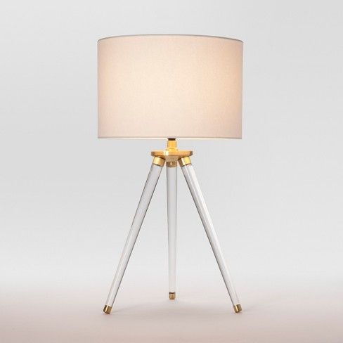 Brighten up any room with the striking style of the Delavan Tripod Table Lamp from Project 62™. Showing off a unique base design, this modern table lamp includes a three-way rotary switch that allows you to keep the light at a high, medium or low setting. The drum-shaped shade brings soft illumination into any room so you can enjoy a warm, relaxing ambience.<br><br>1962 was a big year. Modernist design hit its peak and moved into homes across the country. And in Minnesota...