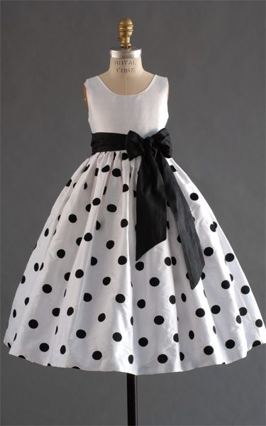 White with black polka dot flower girl's dress.