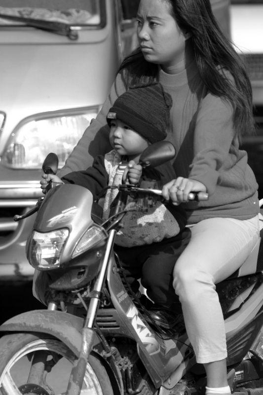 Women and child on motorbike in Phnom Penh.