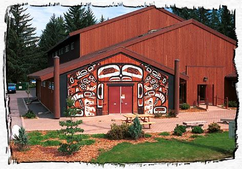 """House of 'Sim Oi Ghets' at the Kitsumkalum Reserve, Terrace, British Columbia, Canada  - photo by Kurt's Photo Studio   ...The name means """"House of Chiefs"""" in the Tsimshian language. Built in 1971, it was rebuilt in 1995 to resemble a traditional long house. Artist Freda Diesing's designs show the four main crests of Kitsumkalum: Eagle, Killer Whale, Raven, and Wolf, with a Robin on top. The Robin is linked to the legend of how and why the First Nations' people settled here…"""