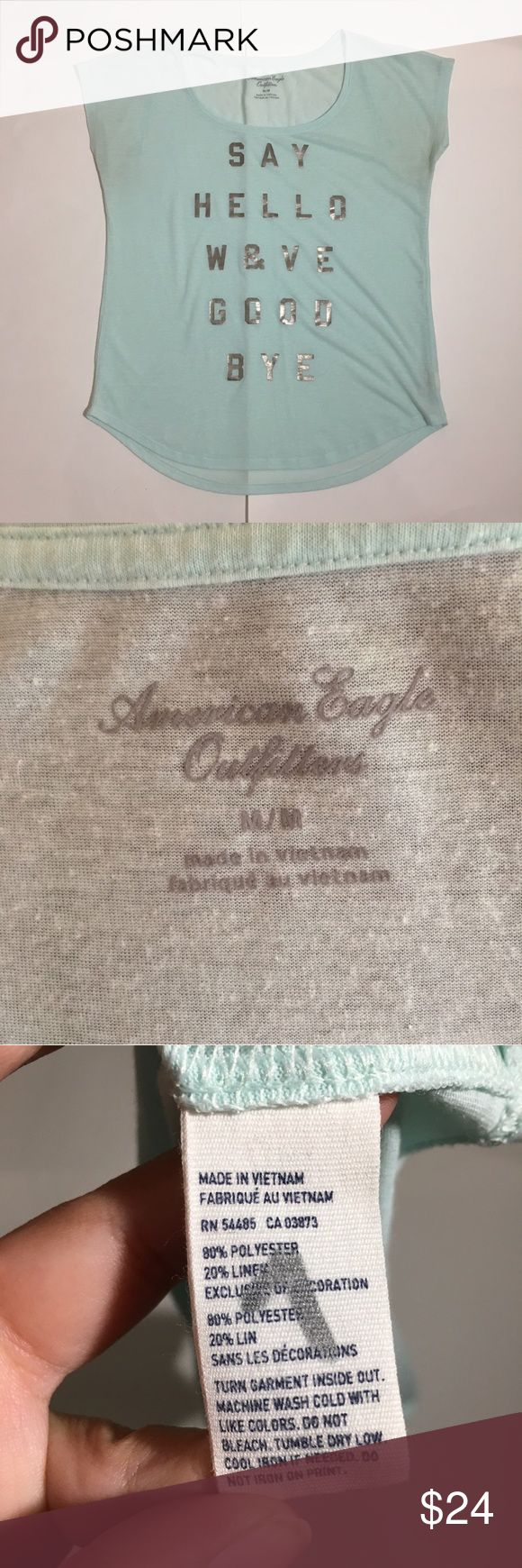"""American Eagle  """"Say Hello Wave Goodbye"""" Tee M Adorable semi-sheer American Eagle Outfitters seafoam green tee! """"Say Hello Wave Goodbye"""" is the saying on the shirt. Perfect Condition shirt. Size Medium. 80% Polyester, 20% Linen. 22"""" armpit to armpit (laying flat), 25"""" shoulder to hem. American Eagle Outfitters Tops Tees - Short Sleeve"""