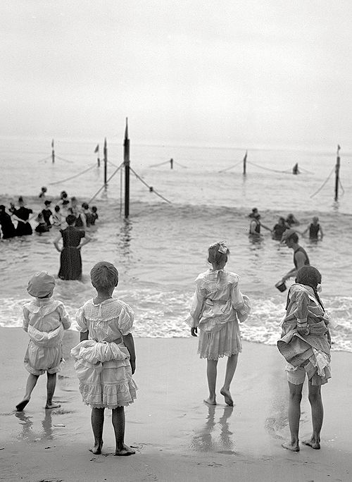 Circa 1905. On the beach at Coney Island.