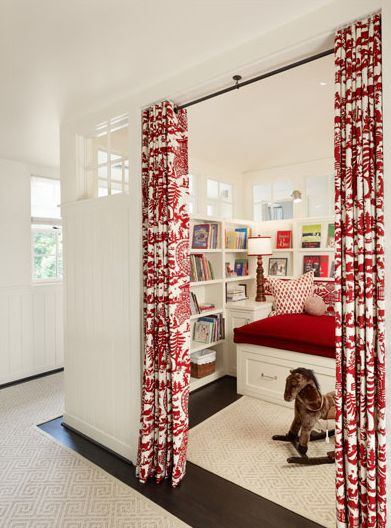 Curtains instead of doors between the office & living room? I also love the upper windows in this room!: