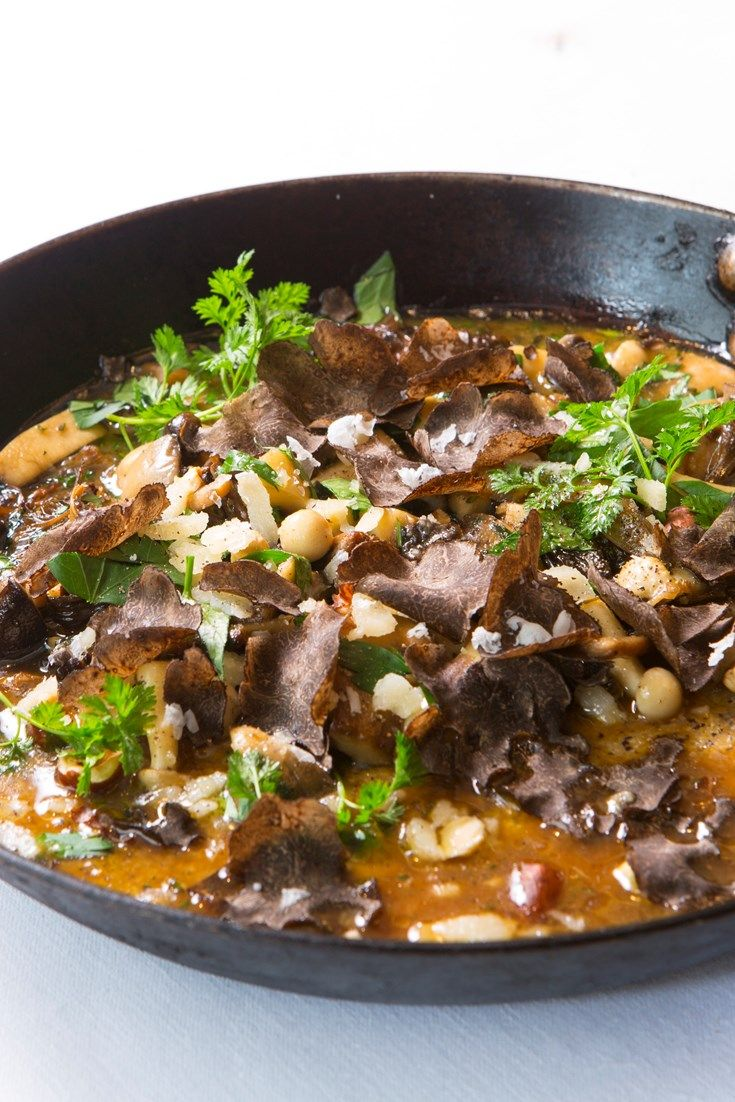 Francesco Mazzei's decadent wild mushroom and polenta ragout recipe is a hearty and rich dish, with a base of creamy black polenta (or mais corvino) topped with a broth of wild mushrooms and lavish shavings of spring truffle.
