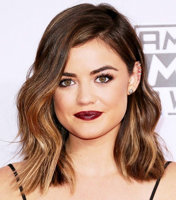 Lucy Hale with a golden high-lighted lob and deep burgundy lip