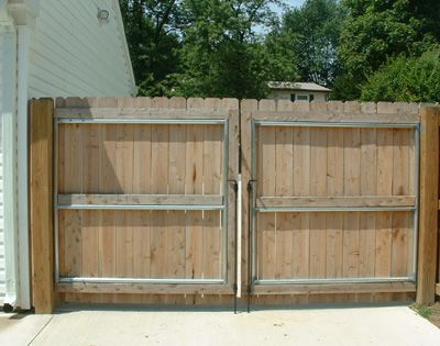 Cedar double drive gate with steel reinforced frame for Double wooden driveway gates