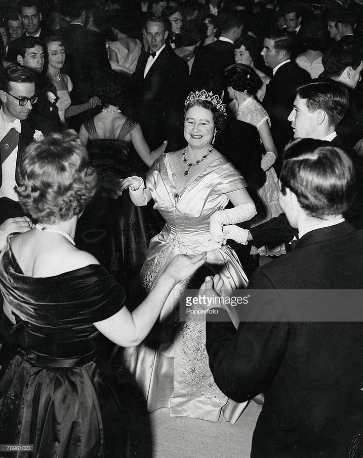 London, England, 28th November, 1958, The Queen Mother dances a fightsome-Reel with some students at the University of London Union President's dinner Ball at the Senate House of London University  (Photo by Popperfoto/Getty Images)