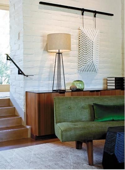 Love this green couch & the house is quite nice as well; Designer Charles de Lisle