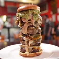 The Burn Out. This towering creation boasts six patties and a blazing ghost pepper sauce.
