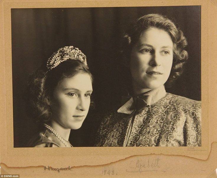 Circa, 1943, London. A signed picture of Princess Margaret (left) and Princess Elizabeth (future Queen, right) from the play Aladdin, a royal pantomime during WWII to raise funds for Royal Household Wool fund, for comfort to the troops.