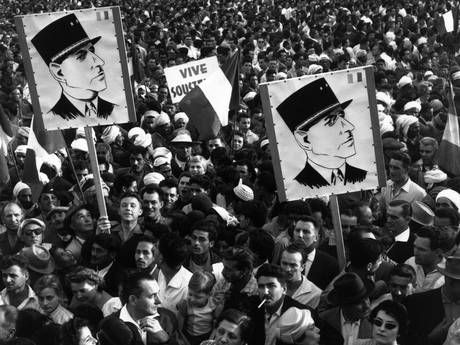 A crowd of Algerian demonstrators outside Government House, carrying Charles de Gaulle posters during the Algerian war of independence in 1985 (Getty Images) 600 of them were slaughtered